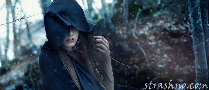 привидение женщины в черном плаще и шляпе